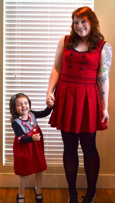 me and my little love bug wearing our Marmalade Forest dresses for Valentine's Day!